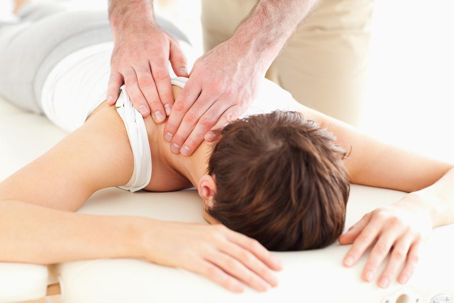 Man Massaging A Woman's Neck